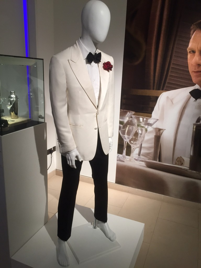 A two-piece dinner suit by Tom Ford, worn by Daniel Craig as James Bond. A single breasted cream silk mix dinner jacket.